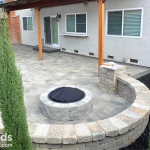 paver patio and fire pit with seating wall