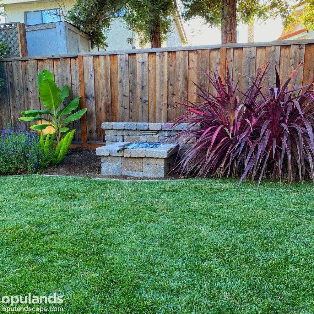 Landscaping job with lawn and paver fountain